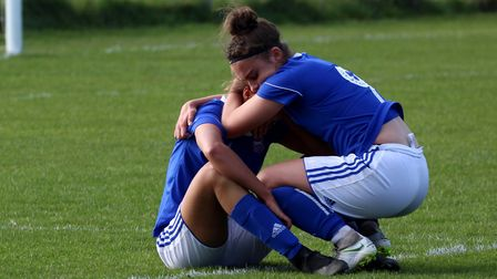 Charlotte Kellett comforts Paige Peake after the final whistle Picture: ROSS HALLS