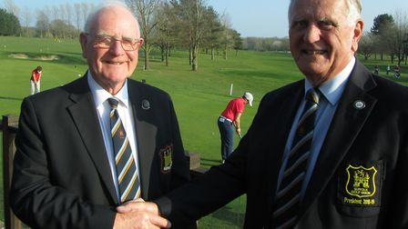 New SGU President Bill Darling of Stowmarket (left) receives his badge from outgoing president Colin