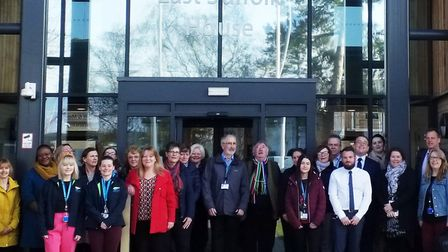 Staff mark the start of the new East Suffolk Council outside the Melton headquarters. Picture: EAST