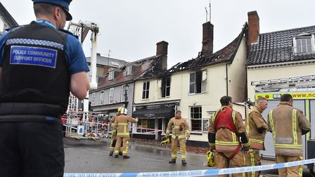 Firefighters and police at the scene of the fire in Halesworth Picture: Nick Butcher