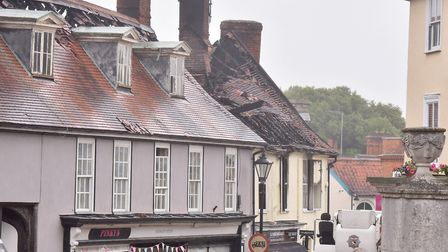 Fire crew attend the scene of a fire at a Newsagents on Market Place, Halesworth. Picture: Nick But