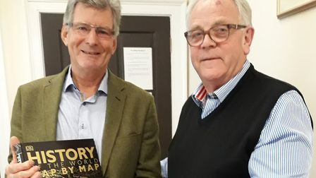 Nick Foster (left) is presented with a book and Cross pen from Citizens Advice chairman Chris Cadman