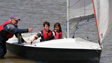 Youngsters test out a boat at Aldeburgh Yacht Club Picture: FLEUR HAYLES/ALDEBURGH SAILING CLUB