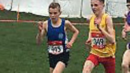 Lewis Sullivan, left, in action in the junior boy's race on his way to victory