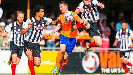 Jon Nolan (right) in action for Grimsby Town against Braintree Town. Photo: Steve Waller