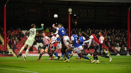 Luke Chambers jumps for a second half free-kick at Brentford Picture Pagepix