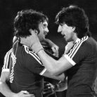 Frans Thijssen and Paul Mariner congratulate John Wark on opening the scoring in a 5-1 trouncing of