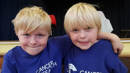 Stanley and Vinny before having their heads shaved to raise money for cancer research. Picture: R