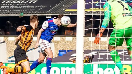 Gwion Edwards heads wide of the post in last weekend's 2-0 home defeat to Hull City. Photo: Steve Wa
