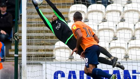 Dillion Barnes makes a first half save, but by this time the U's were already chasing a two goal def