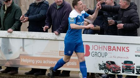 Ollie Hughes celebrates his winning goal with fans at Bury Town. Picture: PAUL VOLLER