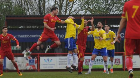 An aerial battle in the 0-0 draw between Needham Market and Stourbridge. Picture: BEN POOLEY