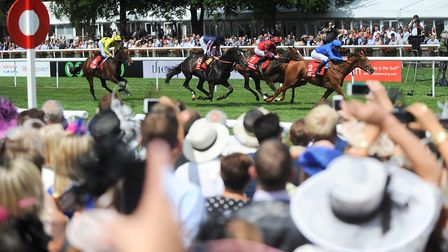 Crowds gather to watch horse racing at Newmarket Ladies Day Picture: GREGG BROWN