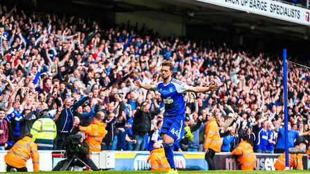 Town fans celebrate as Emyr Huws wheels away after scoring to give Town a 3-1 victory over Newcastle