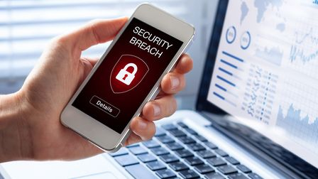 Security breach warning on smartphone screen, device infected by internet virus or malware after cyb