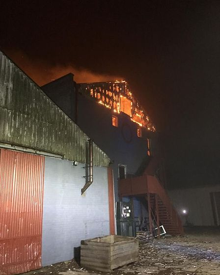 A fire spokesman said the third floor of the building was 'well alight' Picture: SUFFOLK FIRE AND R