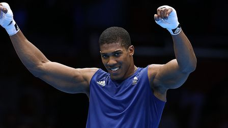 Great Britain's Anthony Joshua celebrates his win against Italy's Roberto Cammarelle in the 2012 Oly