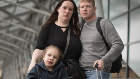 Emma Appleby (left), Lee Moore and their daughter Teagan at Southend Airport Picture: STEFAN ROUSSEA