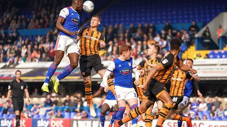 Toto Nsiala soars above Jordy de Wijs in the 2-0 home defeat to Hull City. The Ipswich Town defender