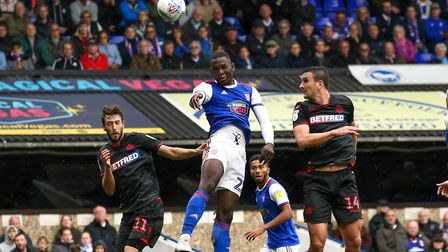 Toto Nsiala wins a header against Bolton early in the season. Photo: Steve Waller
