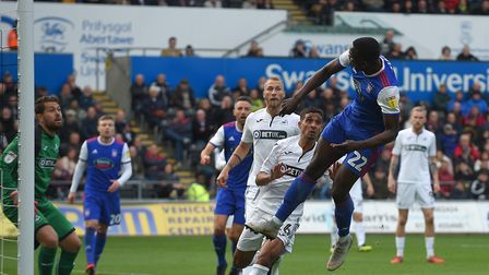 Toto Nsiala stretches to reach a back post header at Swansea. Photo: Pagepix