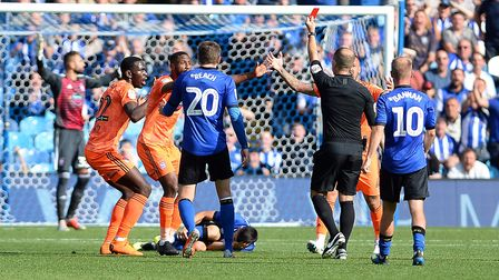 Collective shock as Toto Nsiala is harshly sent off at Sheffield Wednesday. Photo: Pagepix