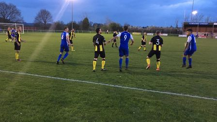 Action from Blackhouse Lane with hosts Cornard United (blue) taking on Debenham. Andy Schofield (No.