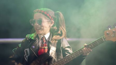The School of Rock band were played by students. Ioli Loyd-Legendre played the bass guitar. Pictures