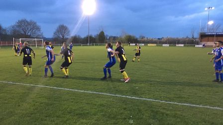 Floodlit action from Tuesday night's Thurlow Nunn One North clash at Great Cornard, which ended in a