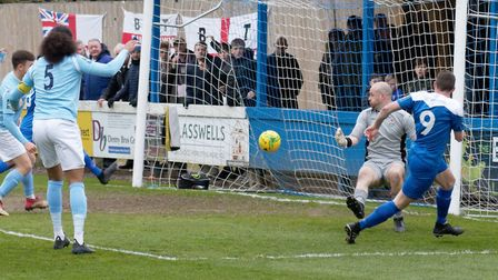 Ollie Hughes fires home the winner during Bury Town's 2-1 win over Brentwood last weekend. Hughes sh