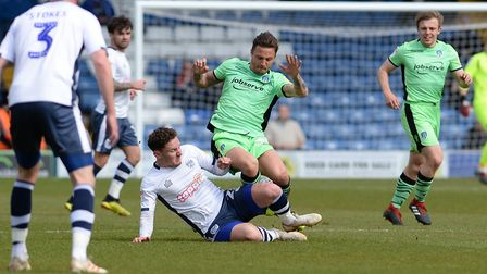 Sam Saunders, on his U's full debut, is challenged during yesterday's 2-0 defeat at Bury. Picture: P