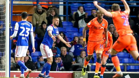 Town skipper Luke Chambers shows his frustration after Tom Elliott had scored Millwall's third a dam