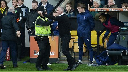Paul Lambert is held back as tempers flare at Carrow Road. Photo: Pagepix