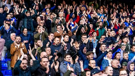 Ipswich Town fans show their support after relegation to League One is confirmed. Photo: Steve Walle
