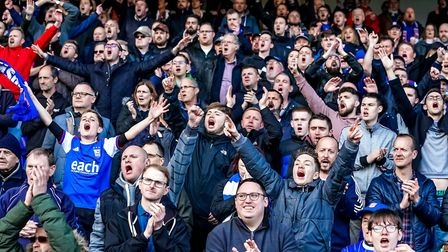 Ipswich Town fans sing their hearts out after relegation to League One is confirmed. Photo: Steve Wa