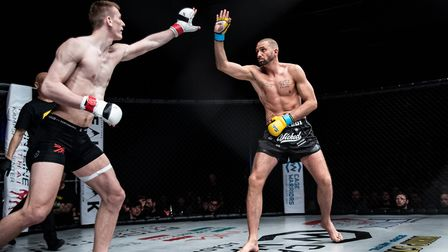 Connor Hayes, left, and Steve Riformato in their middleweight title fight. Picture: BRETT KING