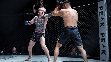 Jimmy Fell, left, put on a fantastic display of heart and guts in his victory at Cage Warriors Acade