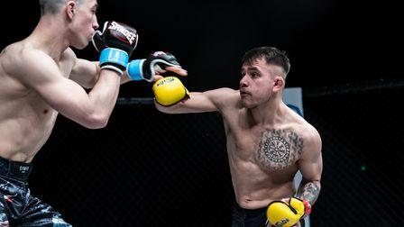 Chey Veal, right, on his way to victory at Cage Warriors Academy South East 23. Picture: BRETT KING