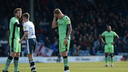 Frankie Kent shows his disappointment at the final whistle, alongside Tom Eastman, left,, following