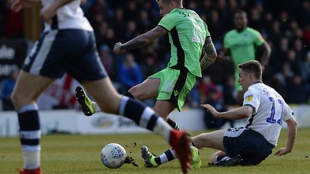 Sammie Szmodics is fouled by Bury midfielder Jordan Rossiter, during the u'S 2-0 defeat at Gigg Lane