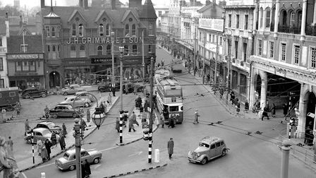 1957. A busy Cornhill, Ipswich in 1957 with bus stops, parked cars and a busy crossroads of traffic.