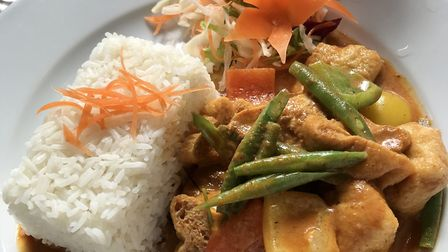 A panang curry with tofu and steamed rice
