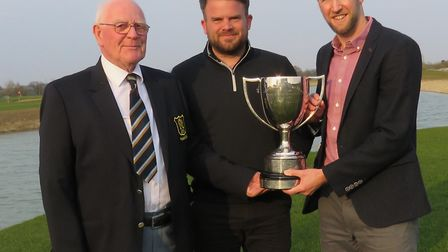 Aldeburgh's James Ollington (centre) and Will Wright, the Suffolk Amateur Foursomes champions, after