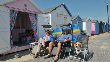 Family days at the seaside. Ali and Graham Ball at their beach hut with their dog Daisy having fun a