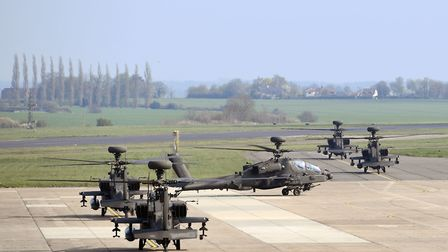 The Apaches taxi out to the runway at Wattisham. Picture: Joe Giddens/PA Wire