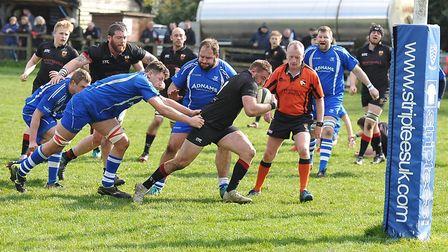 Danny Whiteman surges towards the line to score another Colchester try at Diss. Picture: STEVE WHITE