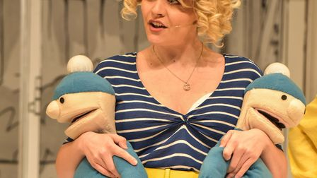 Carole Giles (Christina Tedders) with her twins in Grandma Saves The Day at the New Wolsey Theatre,