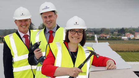 Topping out at the new teaching block at Sybil Andrews Academy. Bury St Edmunds. Mark Bailey of Barn