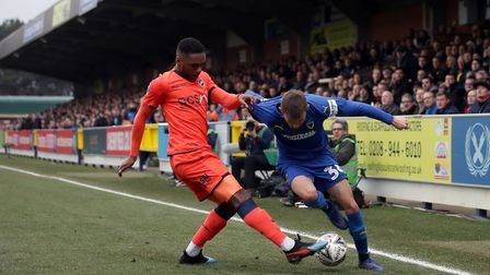 Shane McLoughlin (right) left Ipswich Town in January and is now in AFC Wimbledon's first team. Pic