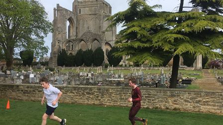 Runners toil into the wind during last Saturday's Snowden Field parkrun, with Crowland Abbey in the